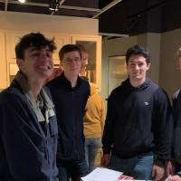 Five students standing in a kitchen museum exhibit in the Arab American Museum